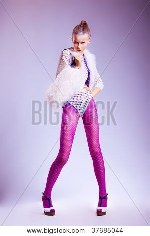 Beauty Female In Pink Erotic Stockings And White Fur Vest