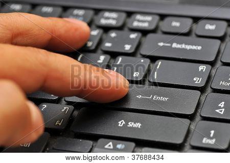 Finger On Computer Keyboard