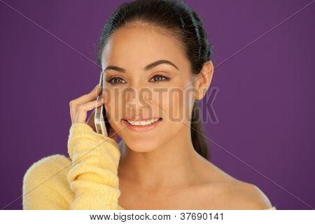 Beautiful Brunette Talking On A Mobile
