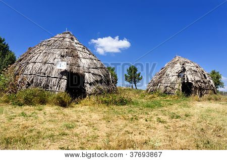 Traditional Straw Huts In Greek Country