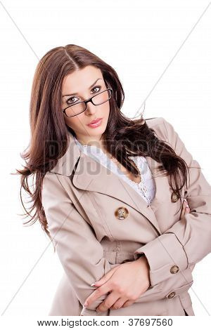 Attractive businesswoman in a coat wearing glasses isolated on white