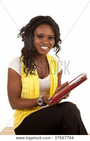 Woman Holding Electronic Pad Looking