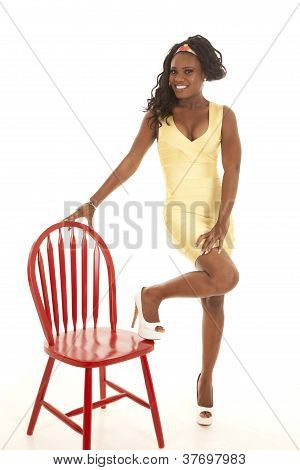 Yellow Dress Red Chair Stand