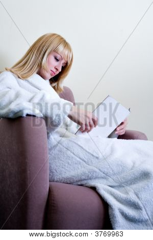 Look-A-Like Reading A Book In Her Bathrobe
