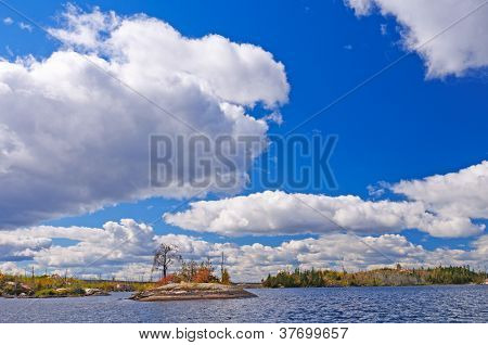High Clouds Over The Blue Water In The Fall