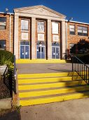 image of school building  - front entrance and steps for an old catholic high school - JPG