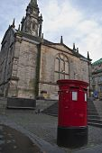 image of square mile  - red postbox on the royal mile in edinburgh - JPG