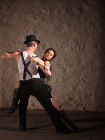 pic of wife-beater  - Passionate dancers performing tango style in urban setting - JPG