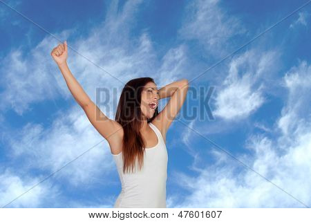 Brunette girl yawning and stretching morning with a blue background of background