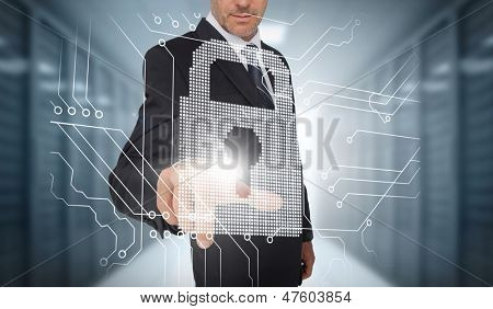 Businessman selecting a futuristic padlock with a data center on the background