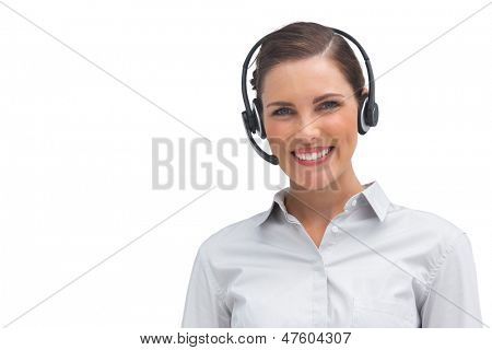 Smiling call centre agent with headset on a white background