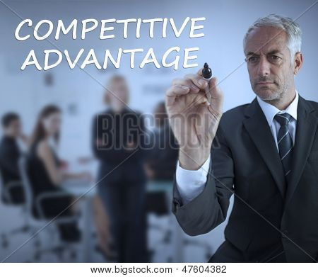 Sophisticated businessman writing competitive advantage during a meeting