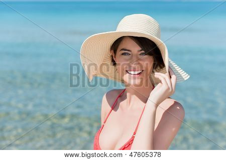 Beautiful Young Woman Posing On A Beach