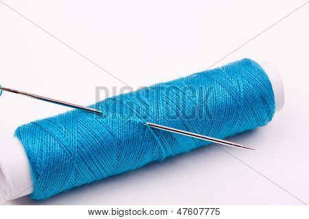 spool of thread and needle