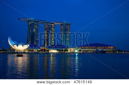 SINGAPORE - FEBRUARY 23: The Marina Bay Sands complex at sunset on February 23, 2013 in Singapore. Marina Bay Sands integrated resort is the world's most expensive standalone casino property.