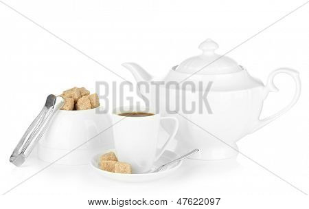 Cup of coffee, sugar-bowl and teapot isolated on white