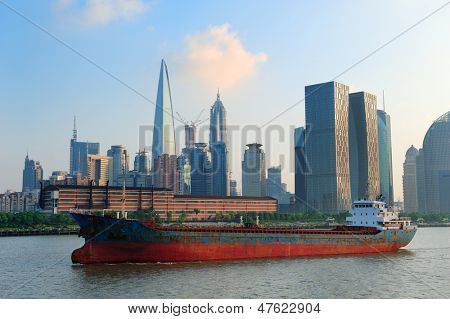 Boat in Huangpu River with Shanghai urban architecture