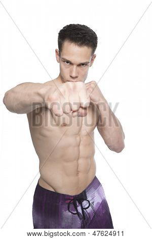 Portrait Of Tough Boxing Guy Punching On White Background
