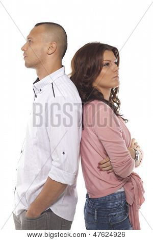 Thoughtful Couple Standing Back To Back Over White Background