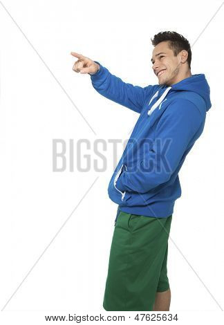 Portrait Of Happy Young Man Pointing On White Background
