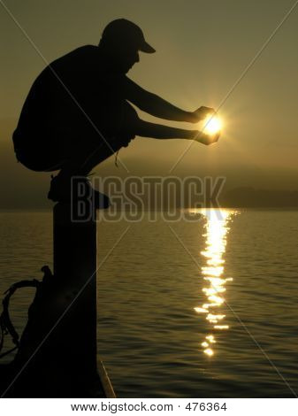 Boy Holding The Sun