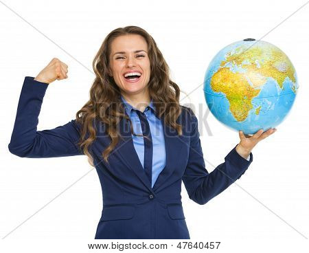 Happy Business Woman Showing Earth Globe And Biceps