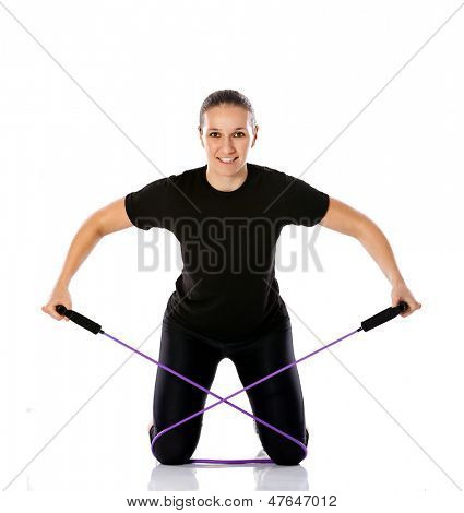 Professional sporty woman exercising with a resistance band