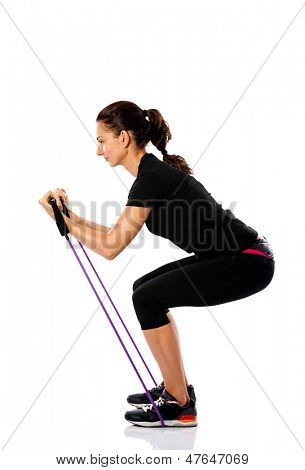 young sporty woman exercising with a resistance rope