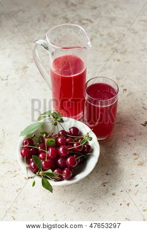 Homemade cherry juice with fresh sour cherries