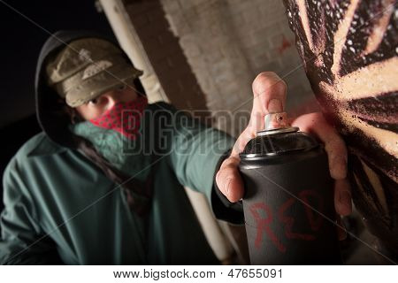 Criminal Holding Up Spray Can