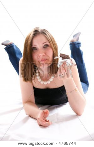 Girl Lying On Floor And Eating Chocolate