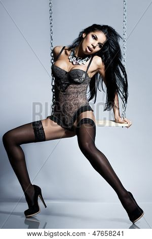 Elegant mulatto girl in lingerie