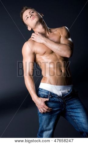 young bodybuilder man on black background