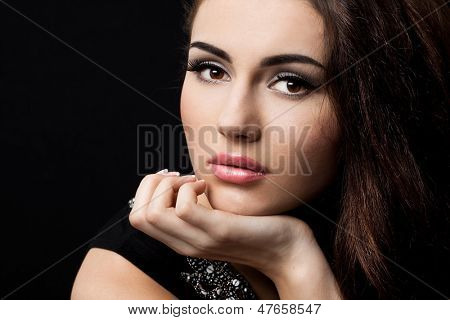 beautiful fashioned woman on black background