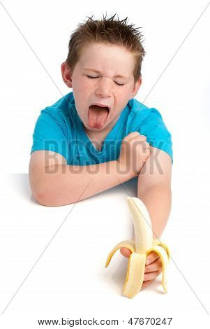 Yound Boy Not Happy About Eating A Banana.