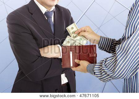 Giving a bribe. Dollar banknotes