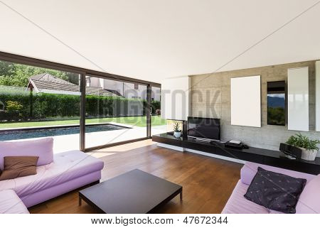 Modern villa, interior, wide living room with pink divan