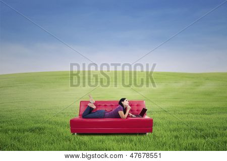 Woman With Laptop On Couch Outdoor