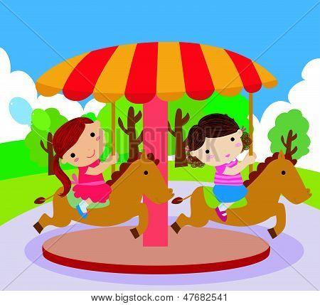 Children ride on the carousel