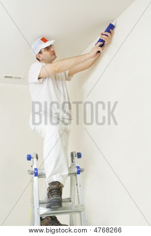 Painter Repairing Cracks