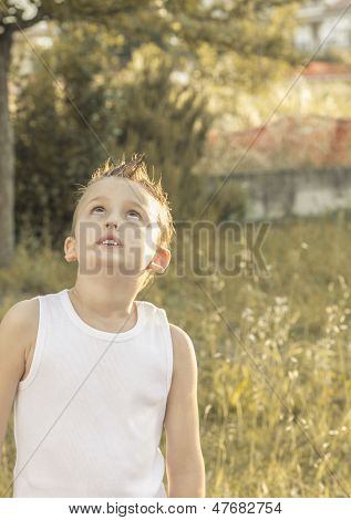 Child Looks Intrigued Into The Sky
