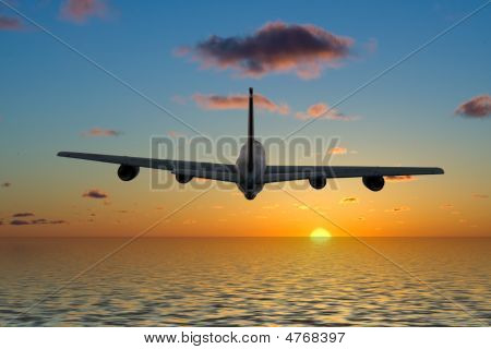 Airplane Flying Into A Beautiful Sunset