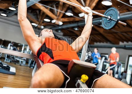 Man lifting a yoke in a fitness club