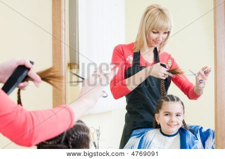 Cute Little Girl In Hairdresser Salon