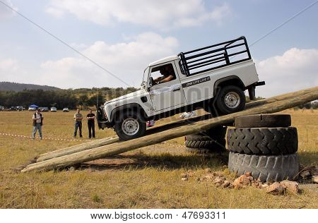 White Land Rover Defender 110 Hc On 4X4 Course
