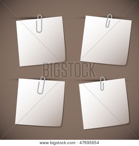 Note Papers With Paperclip On Brown Background