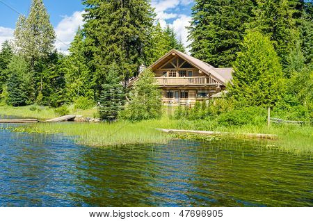 Luxury house over fantastic lake view at sunny day in Vancouver, Canada.