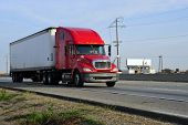 stock photo of 18-wheeler  - Tractor trailer rig speeds down Highway 99 in California - JPG