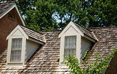 stock photo of gabled dormer window  - Two Wood Dormers on a wood shingled roof - JPG