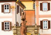 picture of yellow milk cap  - Statue of Grand Master erected 1926 in Twin Houses in Bad Mergentheim in Southern Germany is a beautiful old medieval town with well preserved buildings and castle - JPG